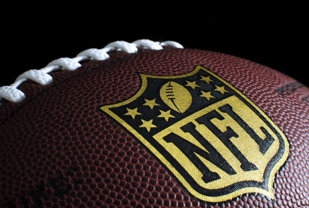 Man selling 'counterfeit' NFL items arrested