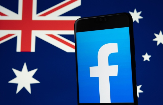 Facebook bans news in Australia, Google pays News Corp